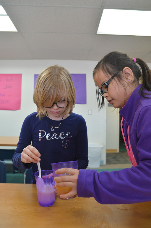 "Justin Sheely | The Sheridan Press<br /> Coffeen Elementary students Cierra Zugel, left, and Samantha Osborne mix ingredients to make ""flubber"" during a Sheridan College elementary education classroom session at the Broadway Center in Sheridan. Sheridan College elementary education students have the unique opportunity to teach their own STEM curriculum and experience a classroom before earning their associate's degree. Typically, an education student would not be exposed to teaching environments until they are working as a student teacher at a four-year college. A partnership with the after school program at Sheridan County School District 2 brings dozens of elementary students to the college's Broadway Center to engage in STEM-based classes taught by the college students."