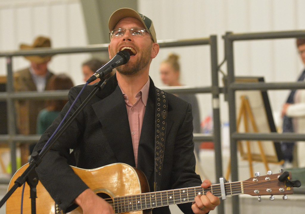 Justin Sheely | The Sheridan Press<br /> JT Craft sings during the CHAPS fundraiser dinner Saturday at the Sheridan College AgriPark arena. CHAPS (Children, Horses and Adults in PartnerShip) is a nonprofit equine assisted therapy program for individuals with special needs.