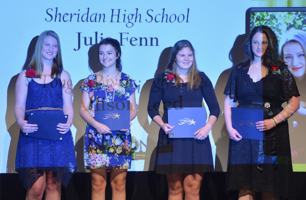 Justin Sheely | The Sheridan Press<br /> Sheridan county students receive the keys to the stone award during the 2016 Keystone Awards Thursday evening at the WYO Theater. From left, Allison Reed, Kaylin McKinley, Julia Fenn and Hannah Sharp.