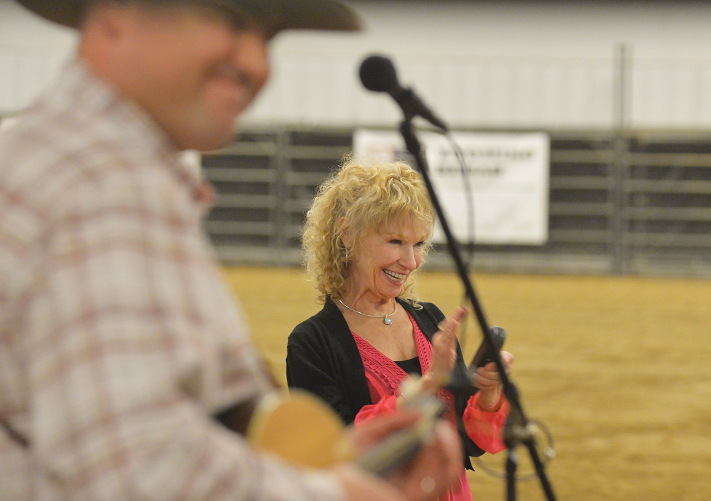 Justin Sheely | The Sheridan Press<br /> Paula Calhoon claps her hands as The Craft Brothers play during the CHAPS fundraiser dinner Saturday at the Sheridan College AgriPark arena. CHAPS (Children, Horses and Adults in PartnerShip) is a nonprofit equine assisted therapy program for individuals with special needs.
