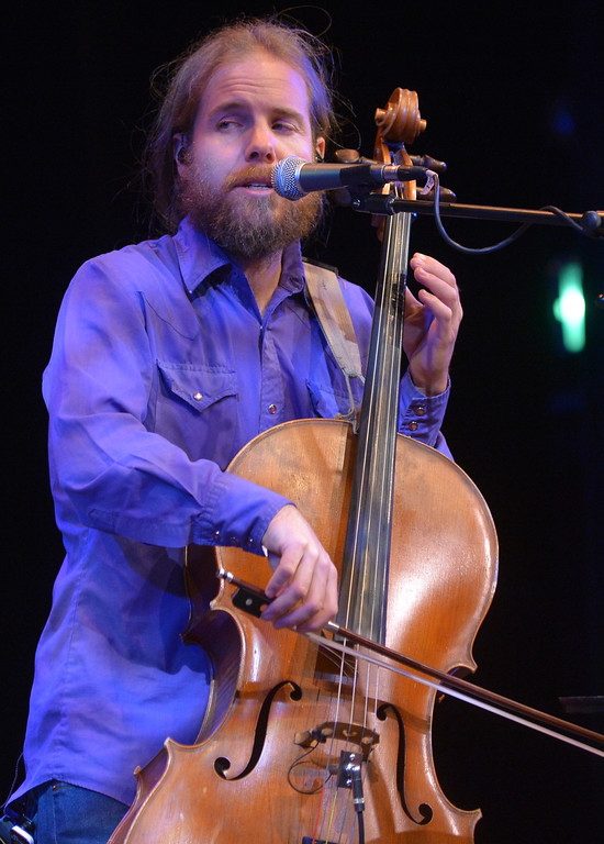 "Justin Sheely | The Sheridan Press<br /> Cellist David Huebner performs during The Two Tracks debut album release concert with the Craft Brothers at the WYO Theater Friday night. The Two Tracks features ""Americana with Wyoming touch"" with original songs written by Julie Szewc."