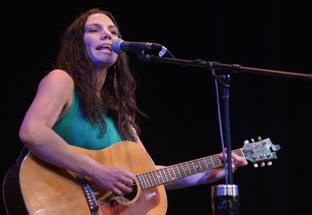 "Justin Sheely | The Sheridan Press<br /> Julie Szewc sings during The Two Tracks debut album release concert with the Craft Brothers at the WYO Theater Friday night. The Two Tracks features ""Americana with Wyoming touch"" with original songs written by Julie Szewc."