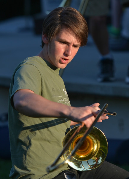 Justin Sheely | The Sheridan Press<br /> Sheridan High School student Sean Gillenwater assembles his trombone during Concert in the Park Tuesday evening at Kendrick Park. The Sheridan Community Band and Bighorn Alphorns played in the final concert for the summer.