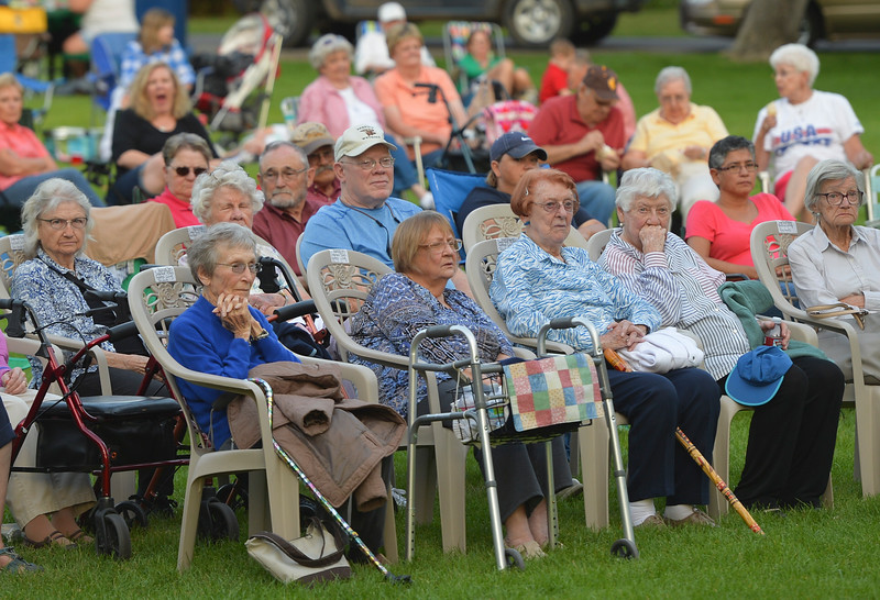 Justin Sheely | The Sheridan Press<br /> Audience members listen to the music during Concert in the Park Tuesday evening at Kendrick Park. The Sheridan Community Band and Bighorn Alphorns played in the final concert for the summer.