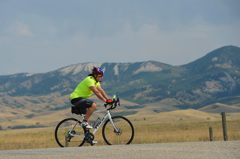 Justin Sheely | The Sheridan Press<br /> A bicyclist takes in the views as he rides up Red Grade Road near Big Horn Wednesday afternoon.
