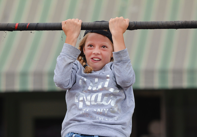Justin Sheely | The Sheridan Press<br /> Twelve-year-old Sarah Ferguson of Ohio tries the chin up bar at the U.S. Marines booth during Third Thursday on Main Street.