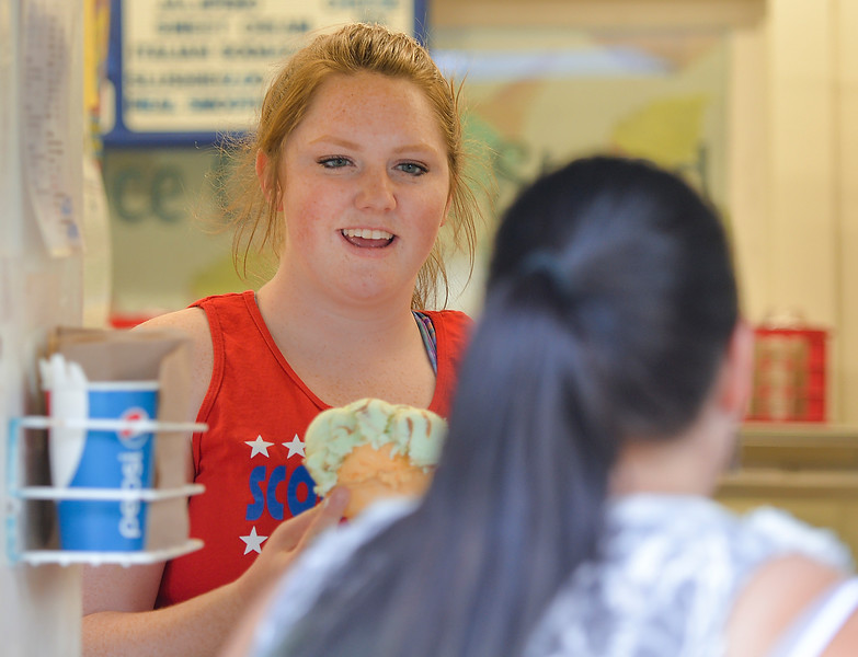 Justin Sheely | The Sheridan Press<br /> Tayci Maxwell serves ice cream to a customer Wednesday evening at Kendrick Ice Cream. The ice cream stand will be closing earlier beginning Monday, August 22 at 8 p.m. Kendrick Ice Cream will close for the season over Labor Day weekend,