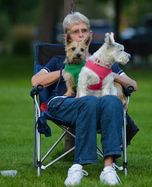 Justin Sheely | The Sheridan Press<br /> Judy Bowie listens to the music with her terriers Jazz and Maggie on her lap during Concert in the Park Tuesday evening at Kendrick Park. The Sheridan Community Band and Bighorn Alphorns played in the final concert for the summer.