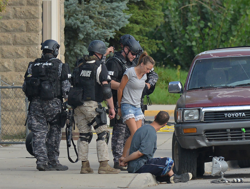 Justin Sheely | The Sheridan Press<br /> The suspect and his girlfriend surrender to law enforcement after a more than 60-hour standoff with police Saturday morning on the 600 block of Broadway. The couple were taken into custody peacefully ending a standoff spanning three days.