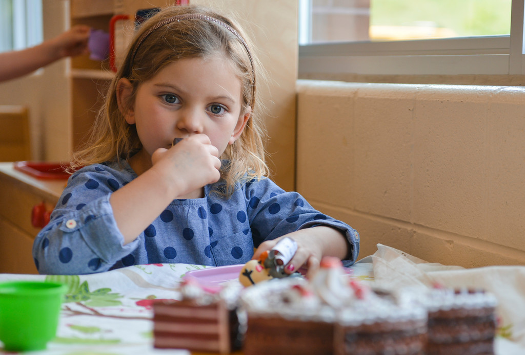 Justin Sheely | The Sheridan Press<br /> Megan Varah pauses as she sits at the tea table during Kindergarten Afterschool Program Friday at the Sheridan YMCA.
