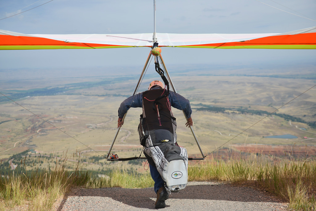 Justin Sheely | The Sheridan Press<br /> Johan Nield picks up his hang glider to launch off during the hang gliders fly-in Saturday at sand turn west of Dayton. Hang gliders from across the nation come to the Bighorn Mountains every Memorial Day and Labor Day weekends to take advantage of the ideal flying condition that the eastern slopes have to offer.