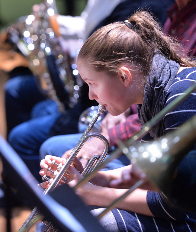 Justin Sheely | The Sheridan Press<br /> Rosborg Holldorsdottir practices on her trumpet during a rehearsal Sunday for Handel's Messiah in the Whitney Center for the Arts concert hall at Sheridan College.