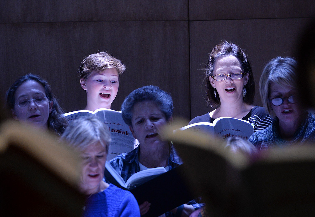 Justin Sheely | The Sheridan Press<br /> Sheridan College choir members Mallory Arneson, 15, and Becki Arneson sing during a rehearsal Sunday for Handel's Messiah in the Whitney Center for the Arts concert hall at Sheridan College.