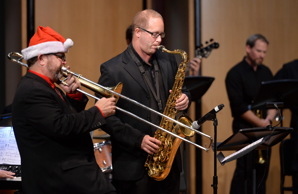 Justin Sheely | The Sheridan Press<br /> Dr. Eric Richards, Director of Bands and Jazz Studies, left, and special guest Tab Barker perform during the Sheridan College Jazz Ensemble's Christmas Swing concert Thursday in the Whitney Center for the Arts concert hall at Sheridan College. The evening's program opened with A Charlie Brown Christmas – Live, arranged by Dr. Christian Erickson, followed by Christmas songs performed by the Jazz Ensemble lead by Dr. Eric Richards. More holiday events will be held at the Whitney Center for the Arts. The Sheridan College Choir performs Dec. 6 at 7:30 p.m. Handel's Messiah, Dec. 9 at 7:30 p.m., featuring the college's orchestra, choir and flute choir.