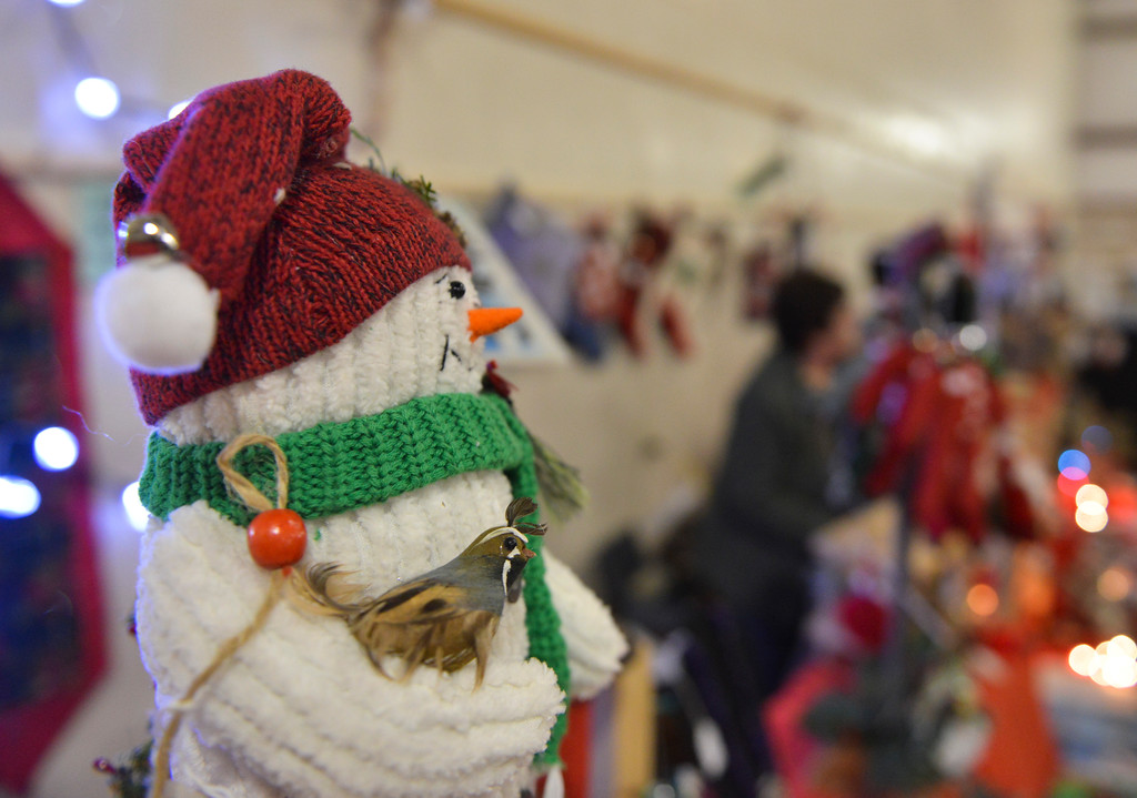 Justin Sheely | The Sheridan Press<br /> A snowman looks over the room during the Mountain Craft Bazaar Saturday at the Ranchester Municipal Building.