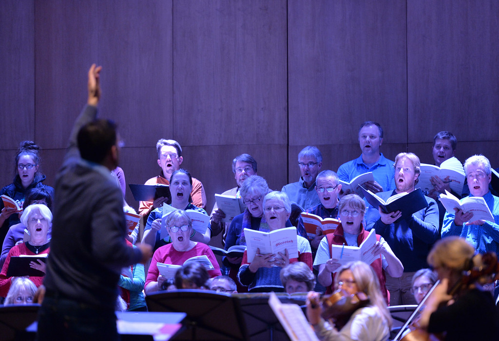 Justin Sheely | The Sheridan Press<br /> Dr. Mark Bergman conducts the choir during a rehearsal Sunday for Handel's Messiah in the Whitney Center for the Arts concert hall at Sheridan College.