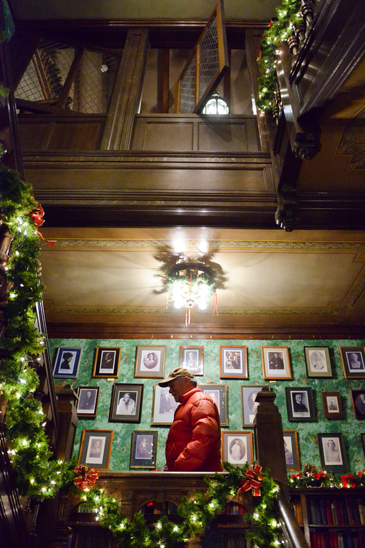 Justin Sheely | The Sheridan Press<br /> Guests climb the stairway during the Holiday Open House at the Trail End State Historic Site Friday evening. Festivities at site, also called Kendrick Mansion, included guest performances, figgy pudding and a visit from Father Christmas.