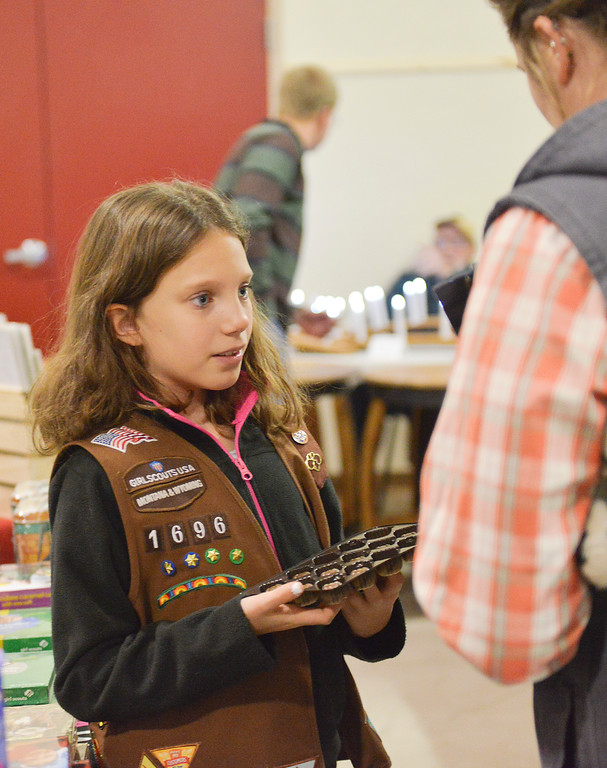 Justin Sheely | The Sheridan Press<br /> Junior Girl Scout Sydney Herrigel, 9, offers sample chocolates to guests during the Mountain Craft Bazaar Saturday at the Ranchester Municipal Building.