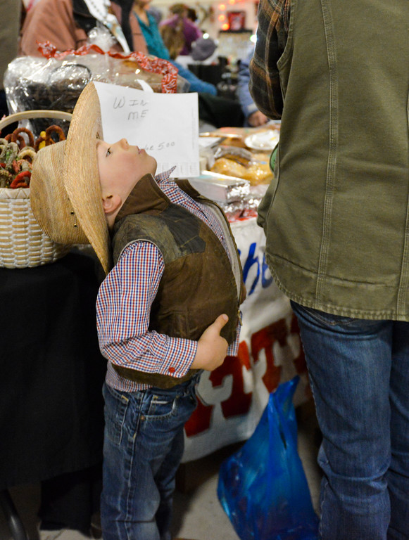 Justin Sheely | The Sheridan Press<br /> Three-year-old JP Reinholz stretches his back as his family browses during the Mountain Craft Bazaar Saturday at the Ranchester Municipal Building.