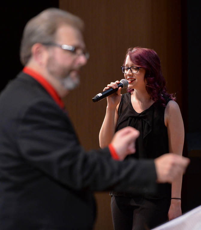 "Justin Sheely | The Sheridan Press<br /> Student vocalist Rebecca Flanders sings ""Santa Claus is Comin' to Town"" during the Sheridan College Jazz Ensemble's Christmas Swing concert Thursday in the Whitney Center for the Arts concert hall at Sheridan College. The evening's program opened with A Charlie Brown Christmas – Live, arranged by Dr. Christian Erickson, followed by Christmas songs performed by the Jazz Ensemble lead by Dr. Eric Richards. More holiday events will be held at the Whitney Center for the Arts. The Sheridan College Choir performs Dec. 6 at 7:30 p.m. Handel's Messiah, Dec. 9 at 7:30 p.m., featuring the college's orchestra, choir and flute choir."
