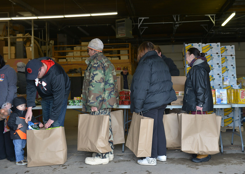 Justin Sheely | The Sheridan Press<br /> Community members queue up for the Wyoming Food Bank of the Rockies holiday meal box distribution Tuesday at Powder River Energy Corporation. The Casper-based non profit sent their mobile unit to Sheridan to provide meals for up to 300 households. The distribution was made possible with grants from WYO Coal, Powder River Energy Corporation and donations from the Sheridan County community.