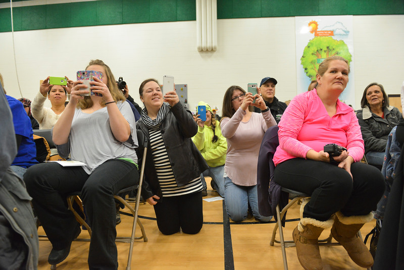 Justin Sheely | The Sheridan Press<br /> Parents and audience members photograph the kindergarteners singing during the Christmas program Tuesday at Coffeen Elementary School.