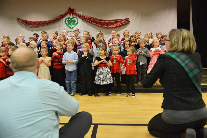 Justin Sheely | The Sheridan Press<br /> Kindergarteners make signs with their hands as they sing a song during the Christmas program Tuesday at Coffeen Elementary School.
