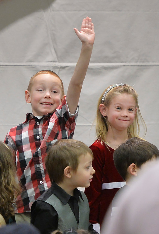 Justin Sheely | The Sheridan Press<br /> Kindergarteners Quintin Thorgeirson, left, and Beth Campbell look for familiar faces in the crowd as the class gets ready to sing during the Christmas program Tuesday at Coffeen Elementary School.