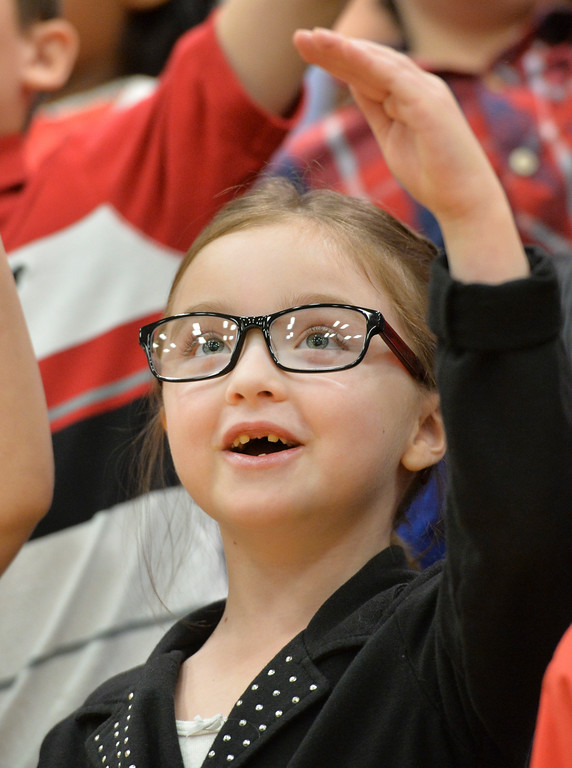 Justin Sheely | The Sheridan Press<br /> First-grader Autumn Meek waves her hand during the Christmas program Tuesday at Coffeen Elementary School.