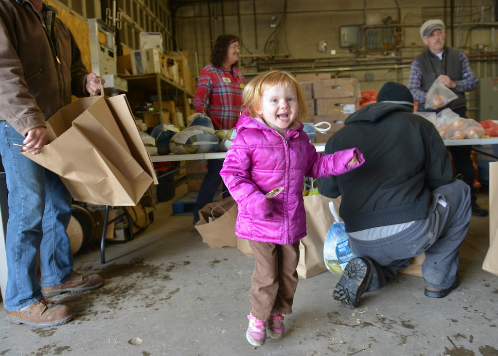 Justin Sheely | The Sheridan Press<br /> Three-year-old Keilee Sawaya jumps with excitement during the Wyoming Food Bank of the Rockies holiday meal box distribution Tuesday at Powder River Energy Corporation. The Casper-based non profit sent their mobile unit to Sheridan to provide meals for up to 300 households. The distribution was made possible with grants from WYO Coal, Powder River Energy Corporation and donations from the Sheridan County community.