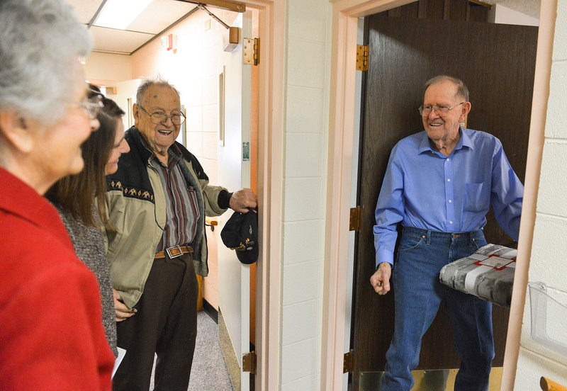 Justin Sheely | The Sheridan Press<br /> Heritage Towers resident Charlie Secrest, right, accepts gifts from Brookdale Sugar Land Ridge residents, left, Wednesday at Heritage Towers. Residents from Sugar Land Ridge donated blankets along with canned and boxed foods to 23 individual seniors living in Sheridan and Dayton. The generous gifting was the idea of Brookdale Living resident Barbara Oedekoven, who said there is a need to provide for seniors without families in the area. The residents hope to make the holiday giving an annual event.