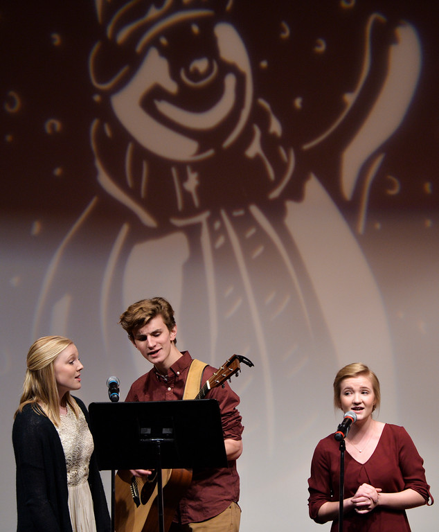 Justin Sheely | The Sheridan Press<br /> Former Youth Chorale members, from left, Heather Heath, Will Craft and Brynn Bateman perform as special guests during the Sheridan County Children's and Youth Chorale presentation Tuesday at the WYO Theater.