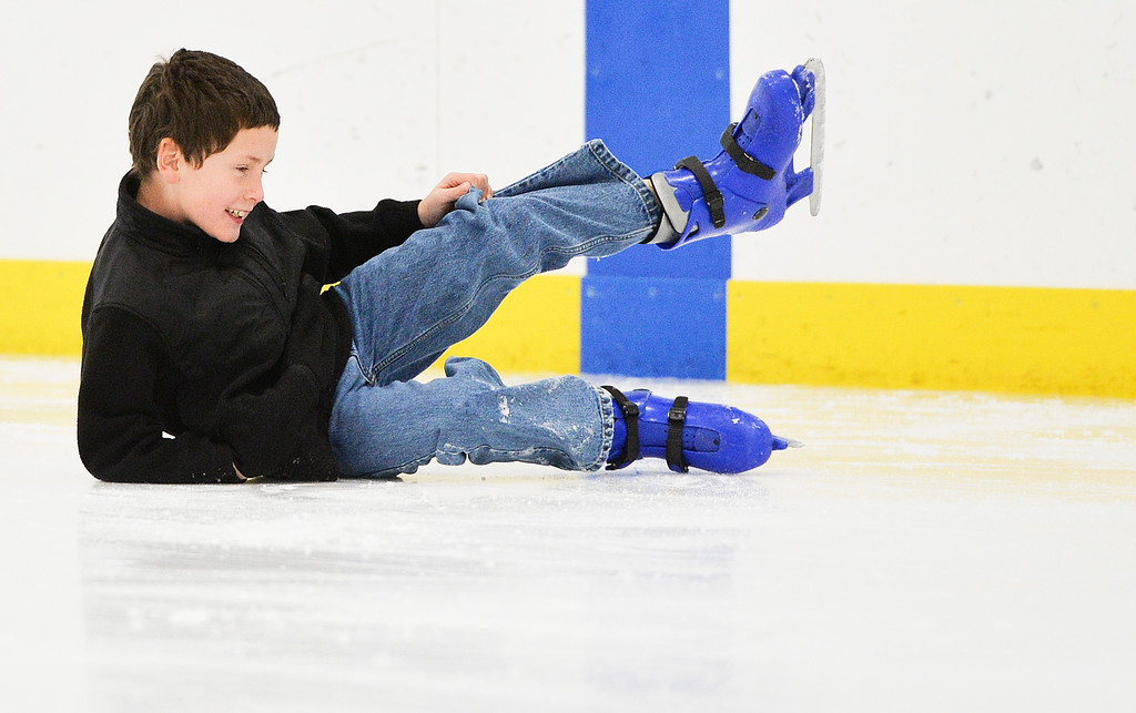 Justin Sheely | The Sheridan Press<br /> Nine-year-old CJ Wilkins takes a spill on the ice during the Tongue River Valley Community Center's Fun Friday visit to Whitney Ice Rink in the M&M's Center on Friday. The community center provides fun activities for Tongue River area students since the school district does not hold class on Fridays.