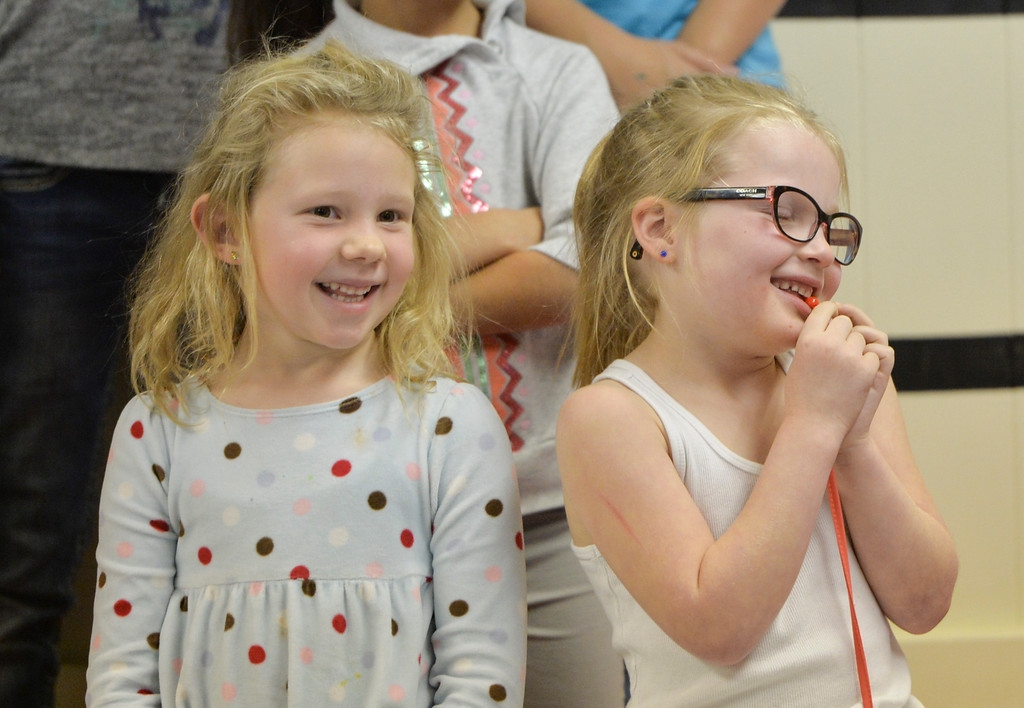 Justin Sheely | The Sheridan Press<br /> Brynlyn Kight, left, and Addison Cassiday show their excitement prior to the Kids Chorus program Thursday at the YMCA. The program is offered for kids Kindergarten through third grade to learn the foundations of music. The program resumes in January at the YMCA.