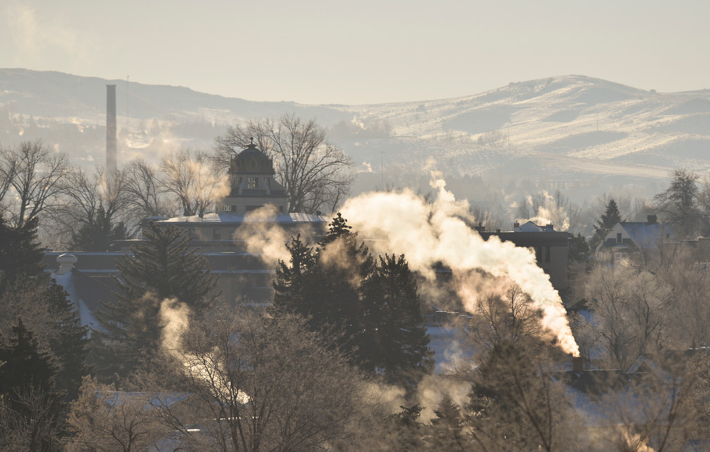 Justin Sheely | The Sheridan Press<br /> Columns of smoke and steam rise from buildings Thursday morning  in downtown Sheridan. Temperature dropped to -12 degrees fahrenheit early Thursday. The weekend is expected to be warmer with chances for snow.