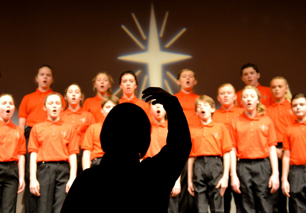 Justin Sheely | The Sheridan Press<br /> Stephanie Zukowski directs the youth chorale for practice prior to the Sheridan County Children's and Youth Chorale performances Tuesday at the WYO Theater.