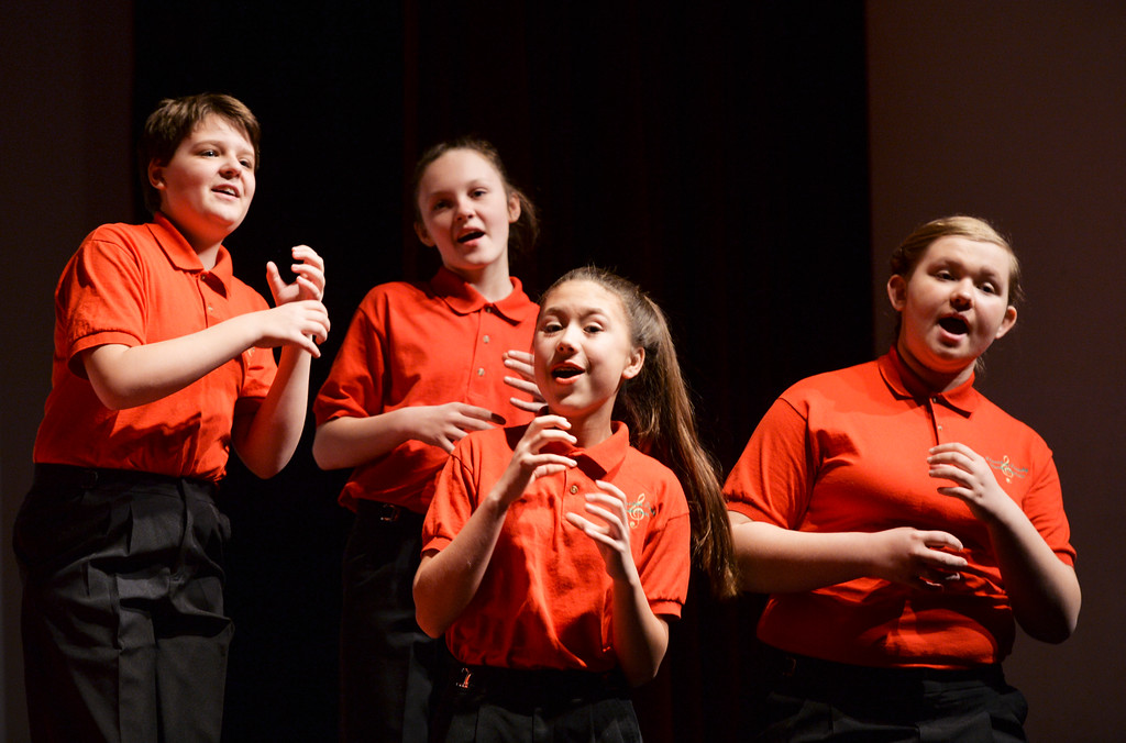 Justin Sheely | The Sheridan Press<br /> Youth chorale members, from left, Sydney Knapp, Kamryn Dygon, Gingi Gonzalez and Emilou Justice practice a song prior to the Sheridan County Children's and Youth Chorale performances Tuesday at the WYO Theater.