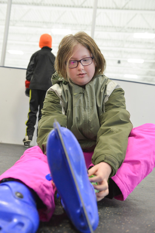 Justin Sheely | The Sheridan Press<br /> Ten-year-old Ashlyn Crandall puts on a pair of skates during the Tongue River Valley Community Center's Fun Friday visit to Whitney Ice Rink in the M&M's Center on Friday. The community center provides fun activities for Tongue River area students since the school district does not hold class on Fridays.