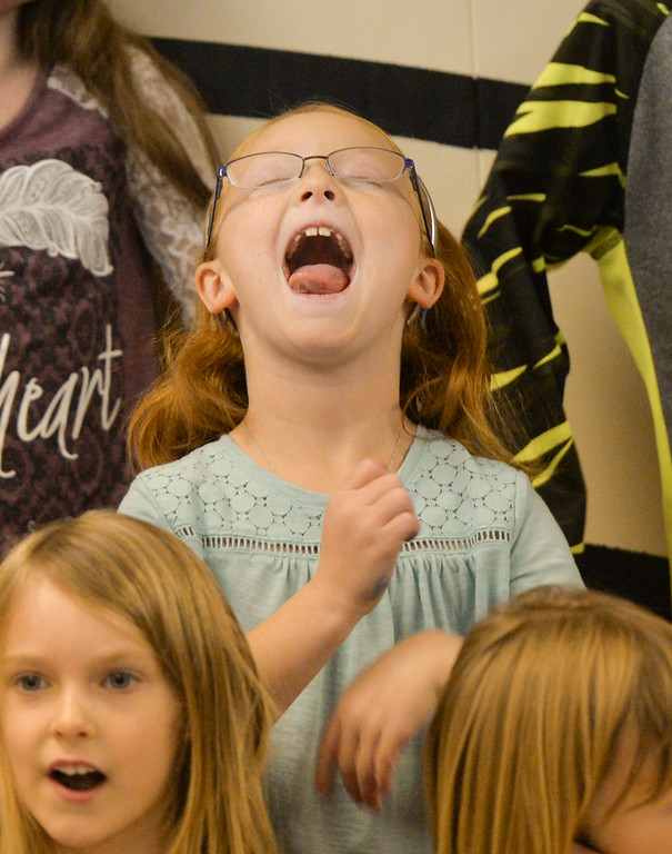 Justin Sheely | The Sheridan Press<br /> Seven-year-old Kate Harper makes a face during the Kids Chorus program Thursday at the YMCA. The program is offered for kids Kindergarten through third grade to learn the foundations of music. The program resumes in January at the YMCA.