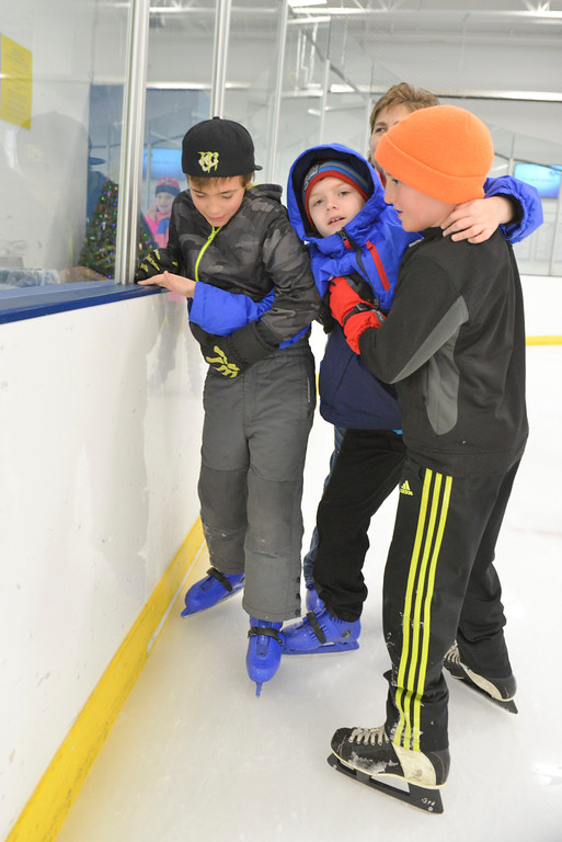 Justin Sheely | The Sheridan Press<br /> Shean Hatfield, middle, is helped over the ice by Kolby McDougall, left, and Andy Simonsen during the Tongue River Valley Community Center's Fun Friday visit to Whitney Ice Rink in the M&M's Center on Friday. The community center provides fun activities for Tongue River area students since the school district does not hold class on Fridays.