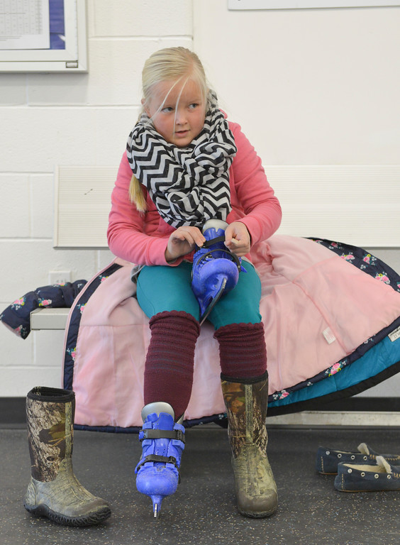 Justin Sheely | The Sheridan Press<br /> Eight-year-old Joni Simonsen puts on a pair of skates during the Tongue River Valley Community Center's Fun Friday visit to Whitney Ice Rink in the M&M's Center on Friday. The community center provides fun activities for Tongue River area students since the school district does not hold class on Fridays.
