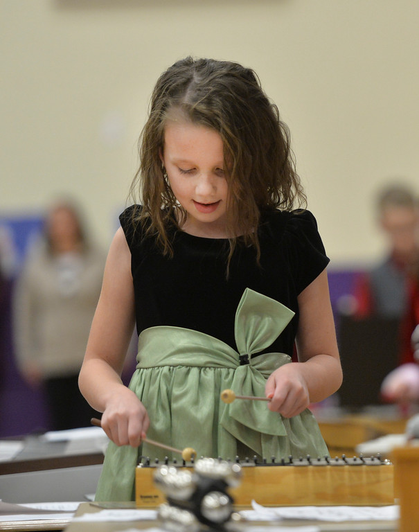 "Justin Sheely | The Sheridan Press<br /> Third-grader Alexa Sanders taps notes on the Glockenspiel during ""Sounds of the Season"" holiday program Tuesday at Woodland Park Elementary School."