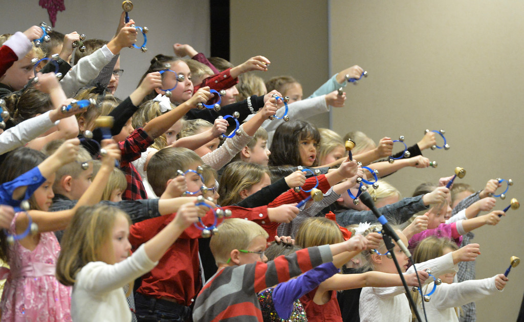 "Justin Sheely | The Sheridan Press<br /> First-graders shake jingle bells during ""Sounds of the Season"" holiday program Tuesday at Woodland Park Elementary School."