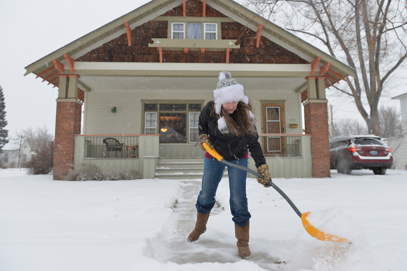 Justin Sheely | The Sheridan Press<br /> Suzann Demple shovels the sidewalk leading to her house Friday morning on Smith Street in Sheridan.