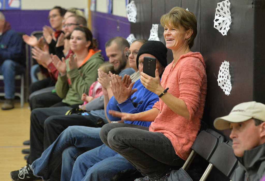"Justin Sheely | The Sheridan Press<br /> Jamie Galloway claps her hand on her thigh after recording a song on her cellphone during ""Sounds of the Season"" holiday program Tuesday at Woodland Park Elementary School."