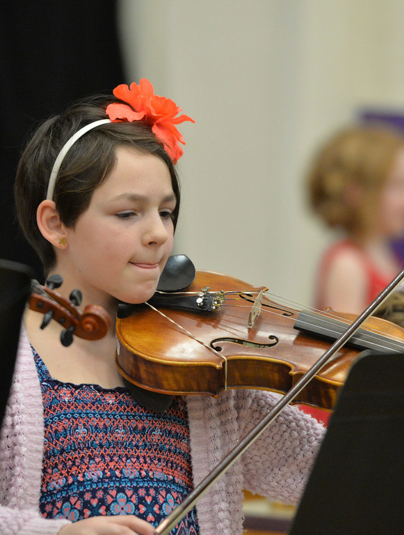 "Justin Sheely | The Sheridan Press<br /> Fifth-grader Sophia Holcomb plays the viola during ""Sounds of the Season"" holiday program Tuesday at Woodland Park Elementary School."