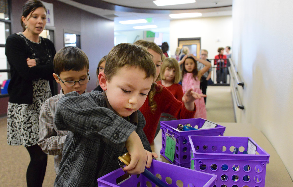 "Justin Sheely | The Sheridan Press<br /> First-grader Zake Fischer picks out an instrument outside the gymnasium during ""Sounds of the Season"" holiday program Tuesday at Woodland Park Elementary School."