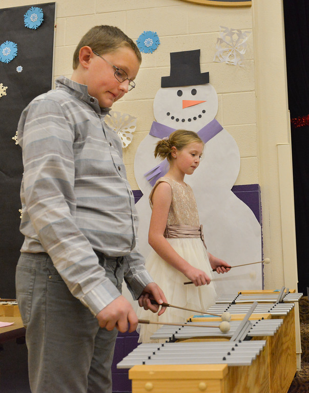 "Justin Sheely | The Sheridan Press<br /> Fifth-graders Jayden Morris, front, and Cameron Cook play Orff instruments during ""Sounds of the Season"" holiday program Tuesday at Woodland Park Elementary School."