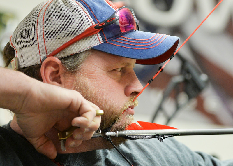 Justin Sheely | The Sheridan Press<br /> Cory Smandych of Calgary, Canada, aims down range during the 1st Annual Wyoming Open Archery Competition Saturday at Rocky Mountain Discount Sports. The event hosted professional player from the region along with local shooters.