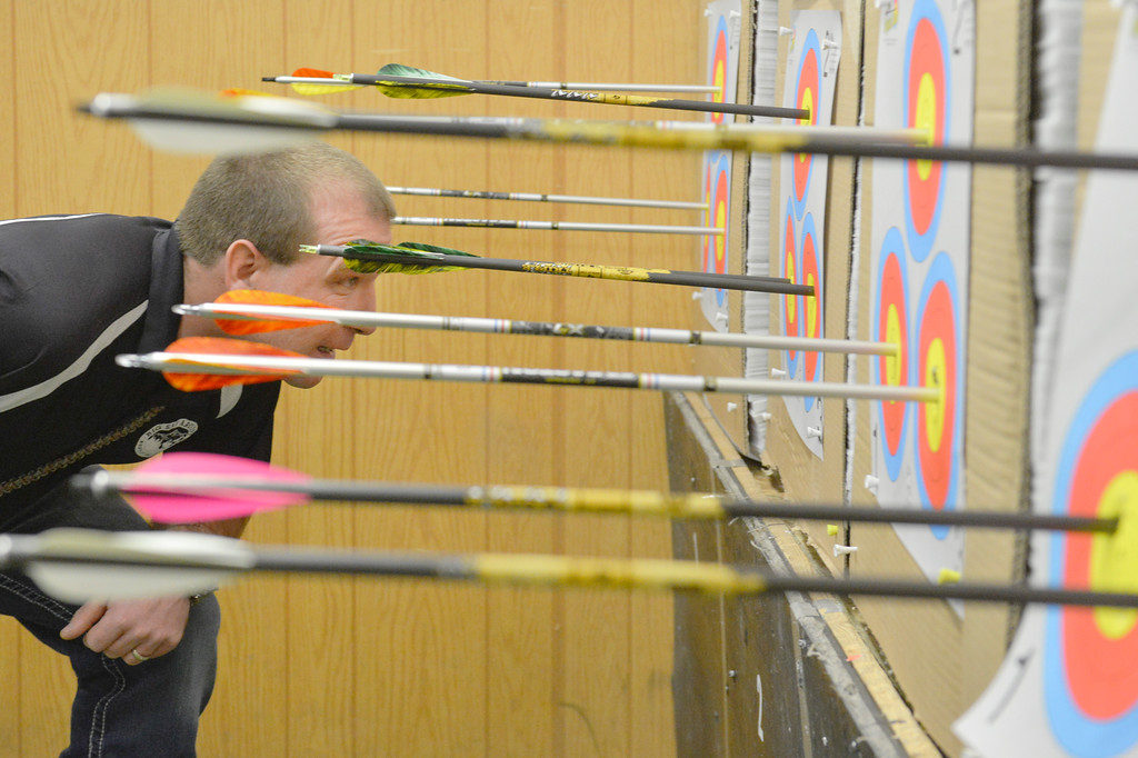 Justin Sheely | The Sheridan Press<br /> Justin Sabol of Billings, Montana, takes a closer look at the targets as the others add scores during the 1st Annual Wyoming Open Archery Competition Saturday at Rocky Mountain Discount Sports. The event hosted professional player from the region along with local shooters.